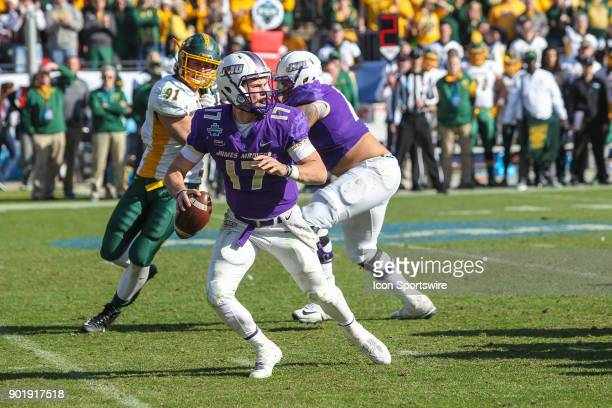 James Madison Dukes quarterback Bryan Schor scrambles during the FCS National Championship game between North Dakota State and James Madison on...