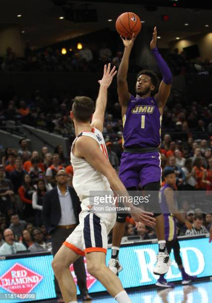 James Madison guard Matt Lewis attempts a jump shot attempt during a game between the James Madison Dukes and the Virginia Cavaliers on November 10...