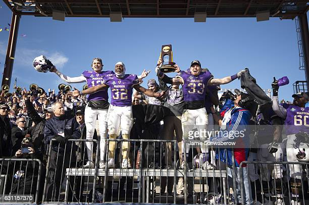 James Madison University celebrates their victory over Youngstown State University during the Division I FCS Football Championship held at Toyota...
