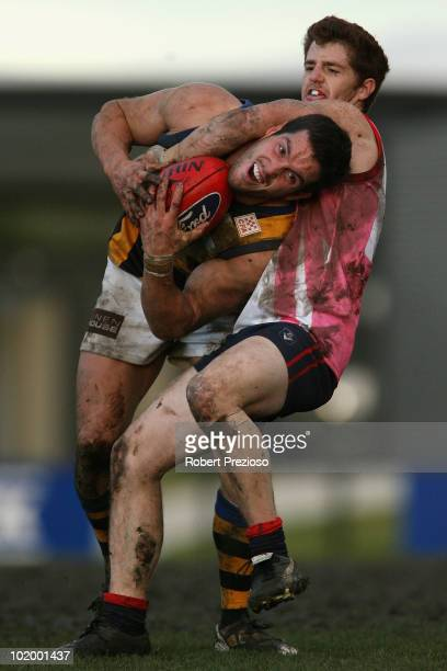 James Magner of Sandringham is tackled by Michael Stockdale of the Scorpions during the round nine VFL match between the Casey Scorpions and...
