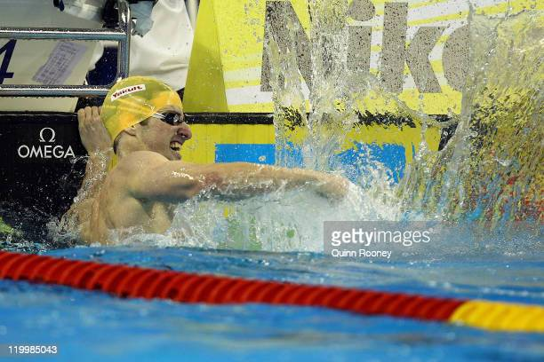 James Magnussen of Australia celebrates the gold medal in the Men's 100m Freestyle Final during Day Thirteen of the 14th FINA World Championships at...