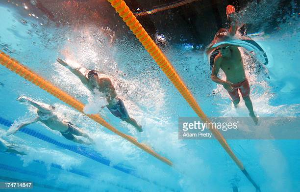 James Magnussen of Australia Nathan Adrian of the USA and Andrey Grechin of Russia the Swimming Men's 4x100m Freestyle on day nine of the 15th FINA...