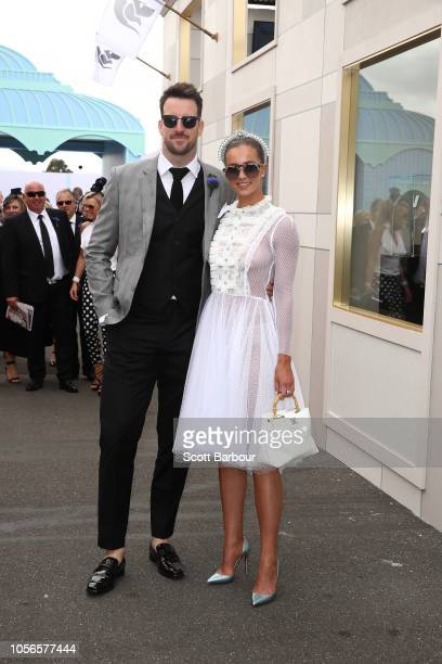 James Magnussen Rose McEvoy poses at the Kennedy Marquee on Derby Day at Flemington Racecourse on November 3 2018 in Melbourne Australia