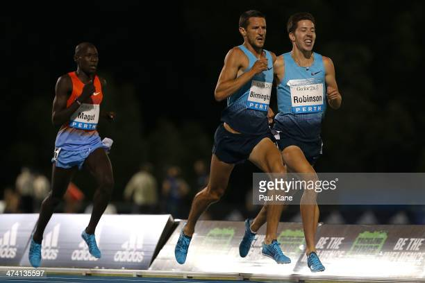 James Magut of Kenya, Collis Birmingham of Australia and Paul Robinson of Ireland compete in the mens Herb Elliott 1 Mile Run during the Perth Track...