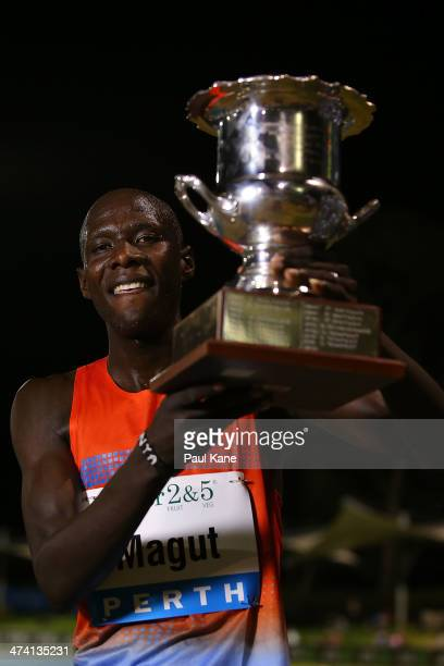 James Magut of Kenya poses with the trophy after winning the mens Herb Elliott 1 Mile Run during the Perth Track Classic at the WA Atheletics Stadium...