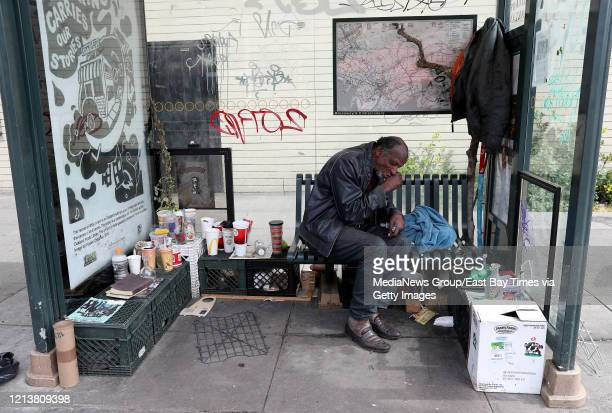 James Mahan, who is homeless, took over a bus stop to live in along Broadway near Jack London Square in Oakland, Calif., on Tuesday, March 17, 2020....
