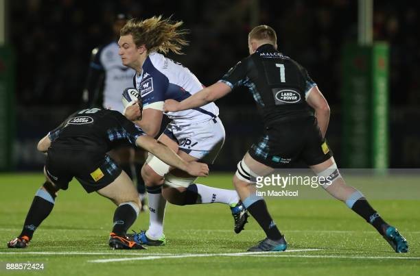 James Malcolm of Glasgow Warriors tackles Jacques Du Plessis of Montpellier during the European Rugby Champions Cup match between Glasgow Warriors...