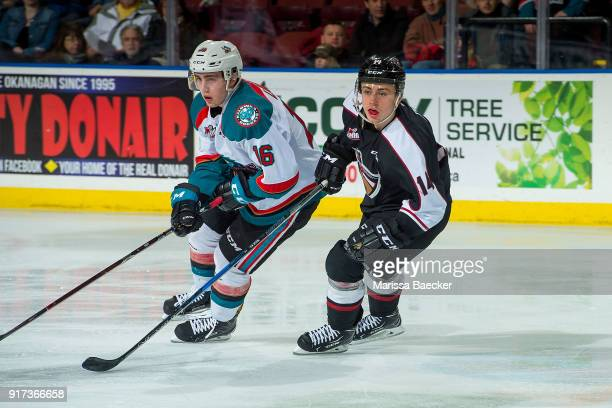 James Malm of the Vancouver Giants checks Kole Lind of the Kelowna Rockets at Prospera Place on February 7 2018 in Kelowna Canada