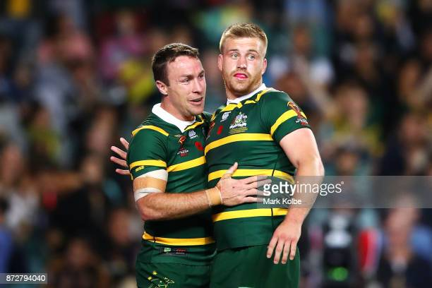 James Maloney and Cameron Munster of Australia celebrate Munster scoring a try during the 2017 Rugby League World Cup match between Australia and...