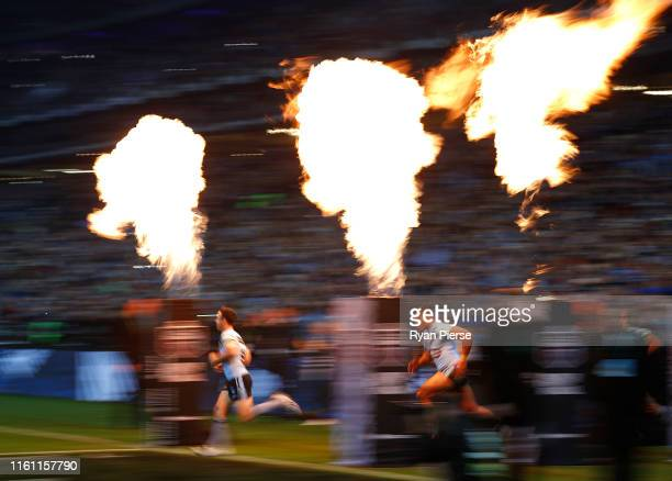 James Maloney and Daniel Saifiti of the Blues run out onto the field during game three of the 2019 State of Origin series between the New South Wales...