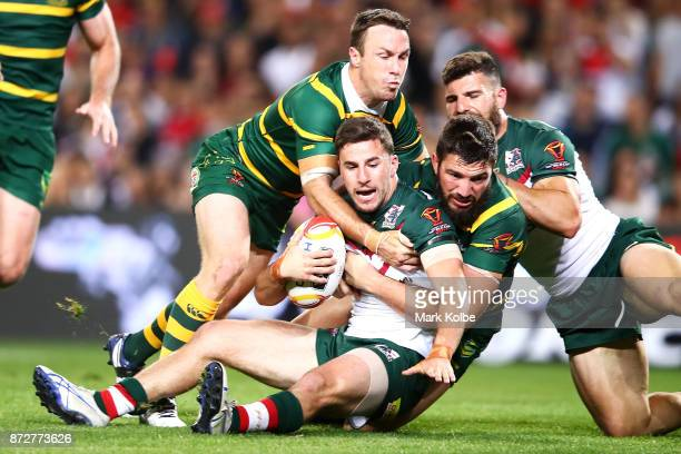 James Maloney and Matt Gillett of Australia tackle Anthony Layoun of Lebanon during the 2017 Rugby League World Cup match between Australia and...