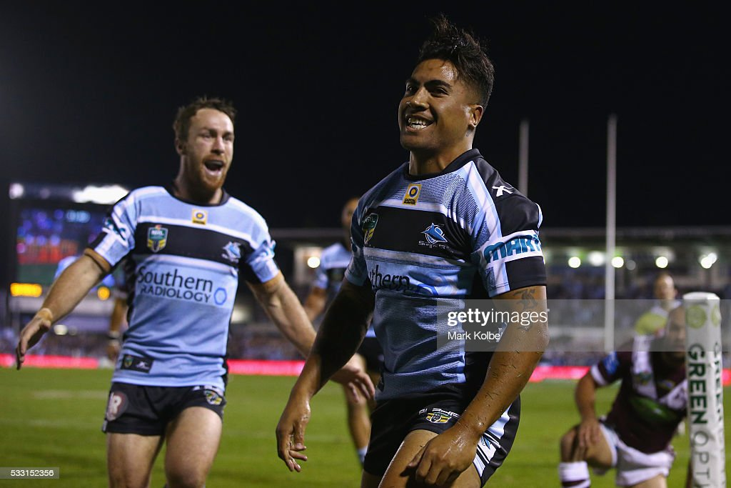 James Maloney and Sosaia Feki of the Sharks celebrate Sosaia Feki scoring a try during the round 11 NRL match between the Cronulla Sharks and the Manly Sea Eagles at Southern Cross Group Stadium on May 21, 2016 in Sydney, Australia.