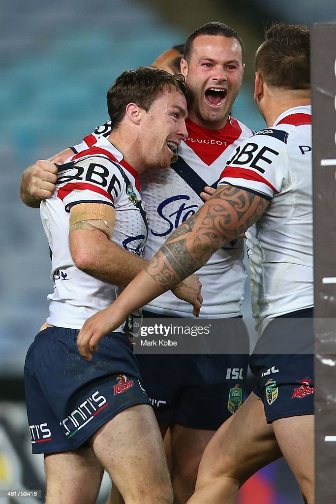 James Maloney, Boyd Cordner and and Jared Waerea-Hargreaves of the Roosters celebrate Maloney scoring a try during the round 20 NRL match between the Wests Tigers and the Sydney Roosters at ANZ Stadium on July 24, 2015 in Sydney, Australia.