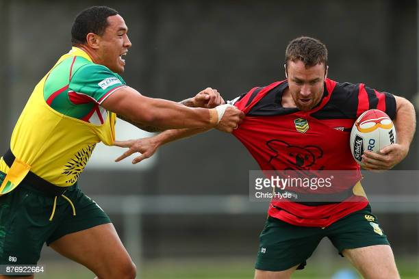 James Maloney is tackeld by Tyson Frizell during an Australian Kangaroos Rugby League World Cup training session at Langlands Park on November 21...