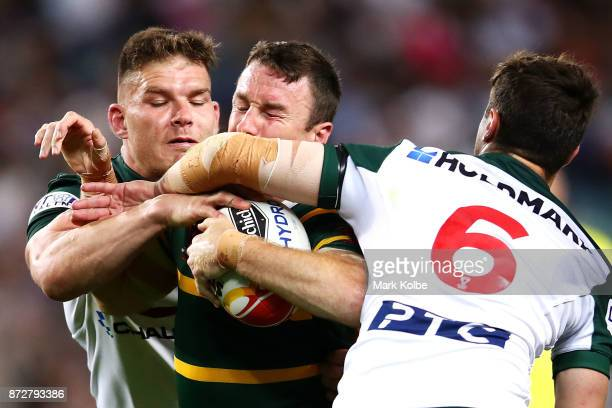 James Maloney of Australia is tackled high by Mitchell Moses of Lebanon during the 2017 Rugby League World Cup match between Australia and Lebanon at...