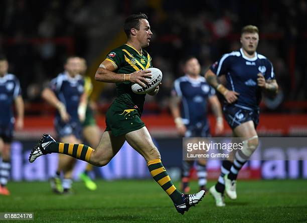 James Maloney of Australia runs in a try during the Four Nations match between the Australian Kangaroos and Scotland at KCOM Lightstream Stadium on...