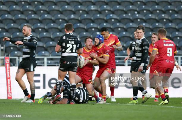James Maloney of Catalan Dragons celebrates scoring with his teammates during the Betfred Super League match between Hull FC and Catalan Dragons at...