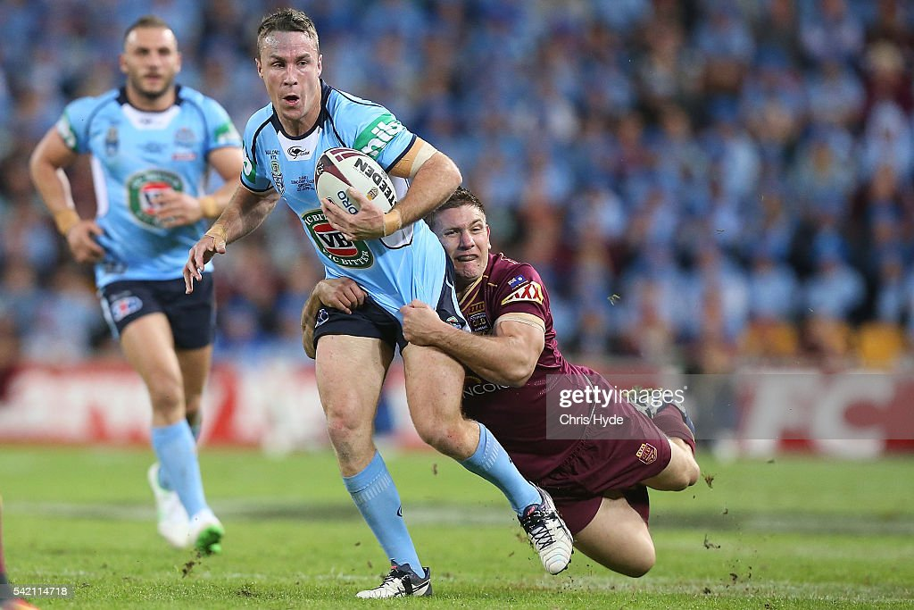 James Maloney of the Blues is tackled by Jacob Lillyman of the Maroons during game two of the State Of Origin series between the Queensland Maroons and the New South Wales Blues at Suncorp Stadium on June 22, 2016 in Brisbane, Australia.