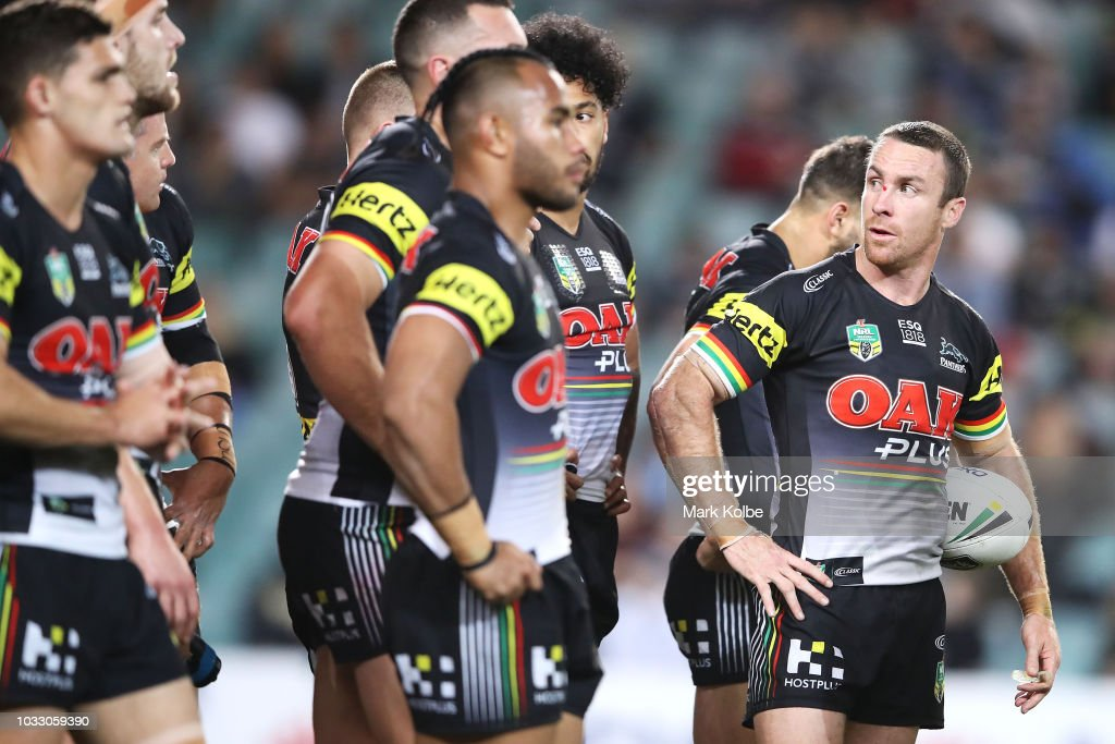 James Maloney of the Panthers and his team mates look dejected after a Sharks try during the NRL Semi Final match between the Cronulla Sharks and the Penrith Panthers at Allianz Stadium on September 14, 2018 in Sydney, Australia.