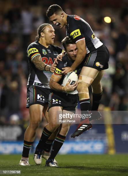 James Maloney of the Panthers and Nathan Cleary of the Panthers celebrates after Maloney scored the winning try during the round 21 NRL match between...