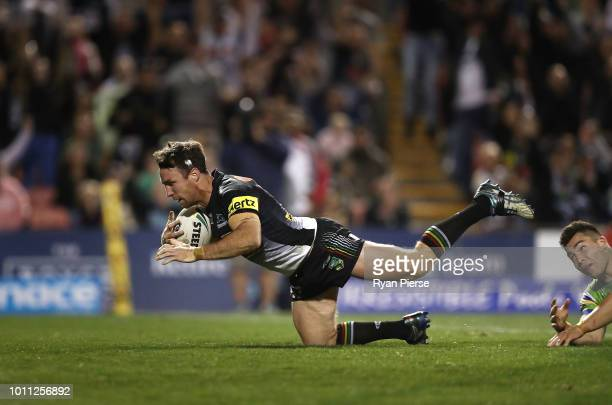 James Maloney of the Panthers crosses to score the winning try during the round 21 NRL match between the Penrith Panthers and the Canberra Raiders at...