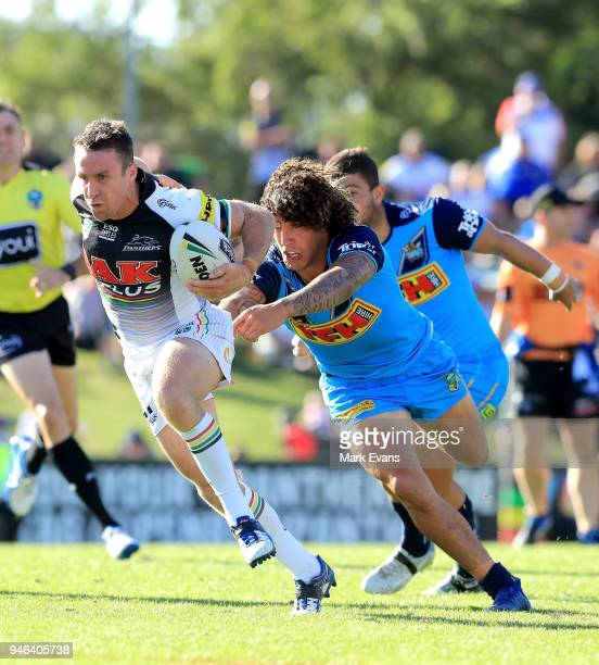 James Maloney of the Panthers gets away from Kevin Proctor of the Titans during the round six NRL match between the Penrith Panthers and the Gold...