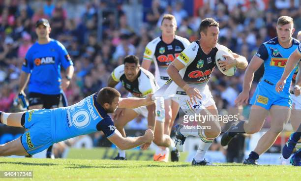 James Maloney of the Panthers is tackled by Max King of the Titans during the round six NRL match between the Penrith Panthers and the Gold Coast...