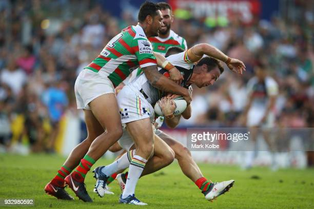 James Maloney of the Panthers is tackled during the round two NRL match between the Penrith Panthers and the South Sydney Rabbitohs at Penrith...