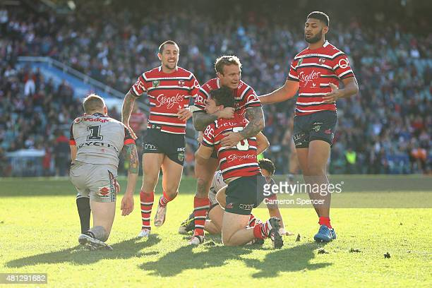 James Maloney of the Roosters celebrates scoring a try during the round 19 NRL match between the Sydney Roosters and the New Zealand Warriors at...