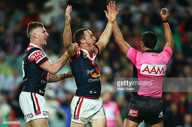 James Maloney of the Roosters celebrates scoring a try during the round 26 NRL match between the Sydney Roosters and the South Sydney Rabbitohs at...
