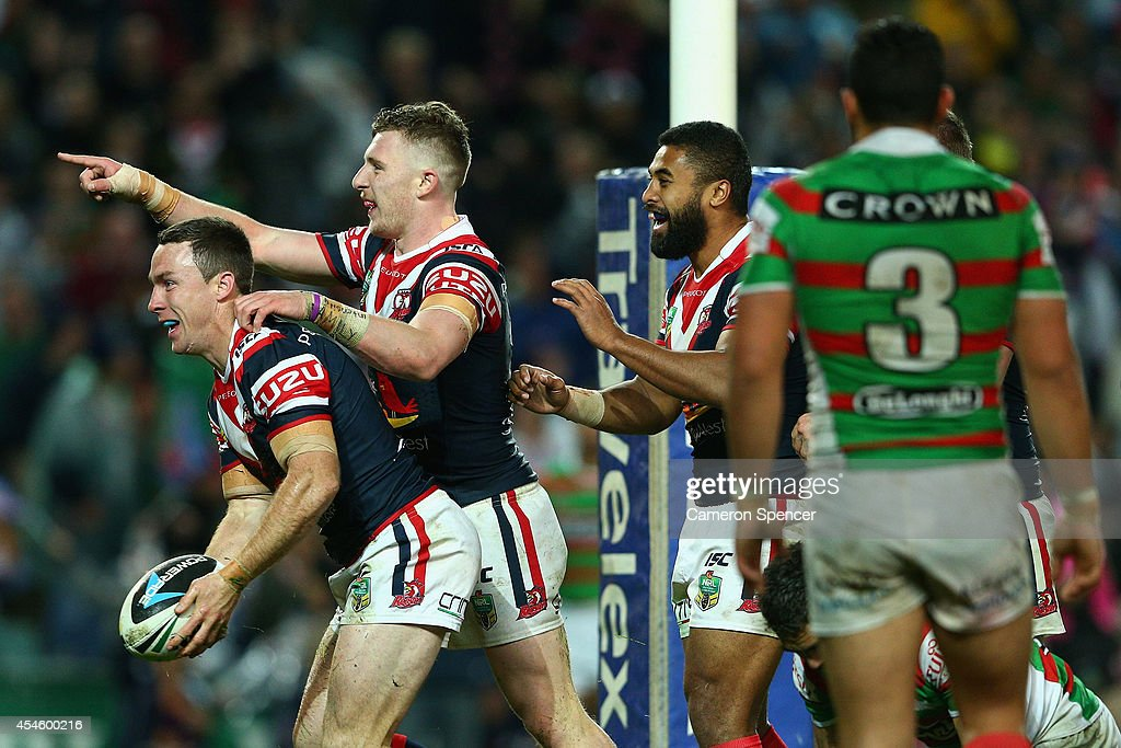 James Maloney of the Roosters celebrates scoring a try during the round 26 NRL match between the Sydney Roosters and the South Sydney Rabbitohs at Allianz Stadium on September 4, 2014 in Sydney, Australia.