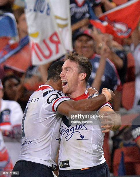James Maloney of the Roosters celebrates scoring a try during the round six NRL match between the Brisbane Broncos and the Sydney Roosters at Suncorp...
