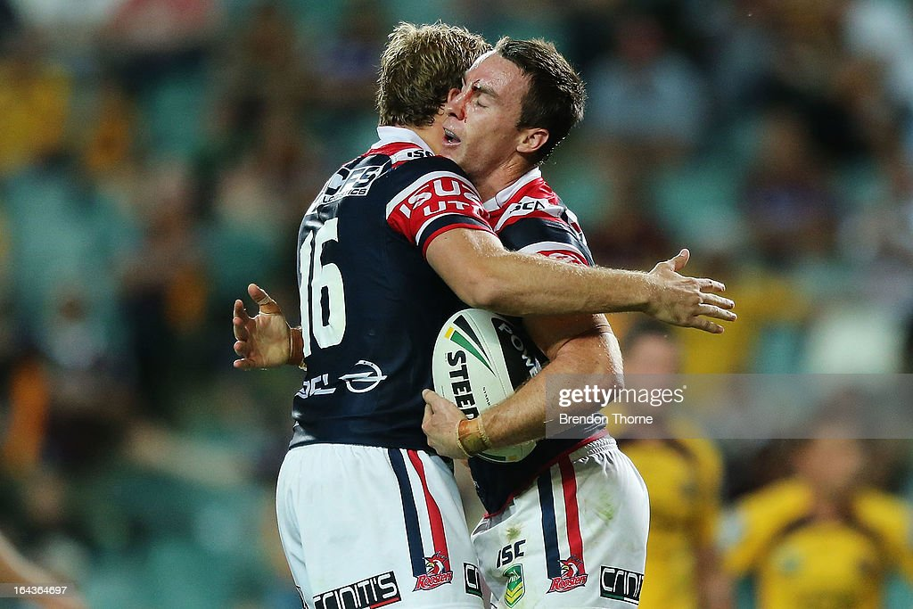 James Maloney of the Roosters celebrates with team mate Mitchell Aubusson after scoring the opening try during the round three NRL match between the Sydney Roosters and the Brisbane Broncos at Allianz Stadium on March 23, 2013 in Sydney, Australia.