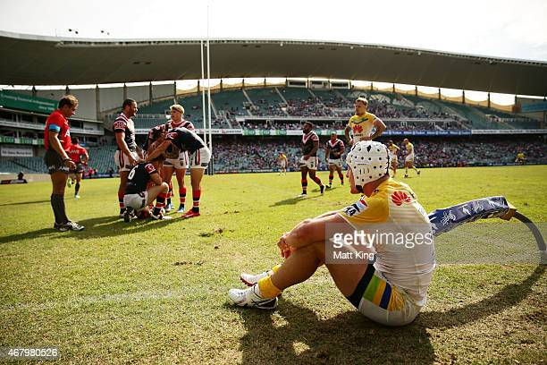 James Maloney of the Roosters celebrates with team mates after scoring a try as Jarrod Croker of the Raiders looks dejected during the round four NRL...