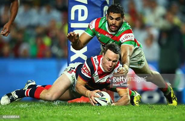 James Maloney of the Roosters dives over to score a try during the round 26 NRL match between the Sydney Roosters and the South Sydney Rabbitohs at...