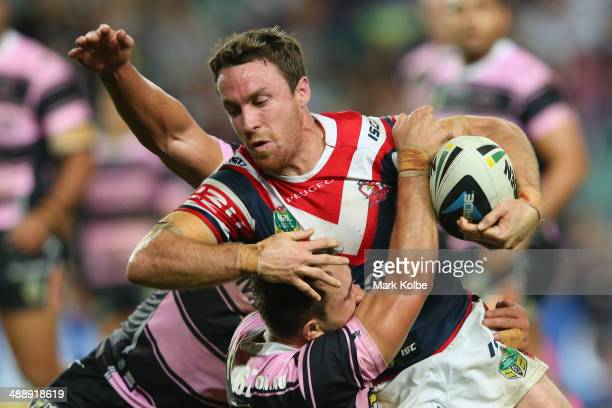 James Maloney of the Roosters is tackled during the round nine NRL match between the Sydney Roosters and the Wests Tigers at Allianz Stadium on May 9...