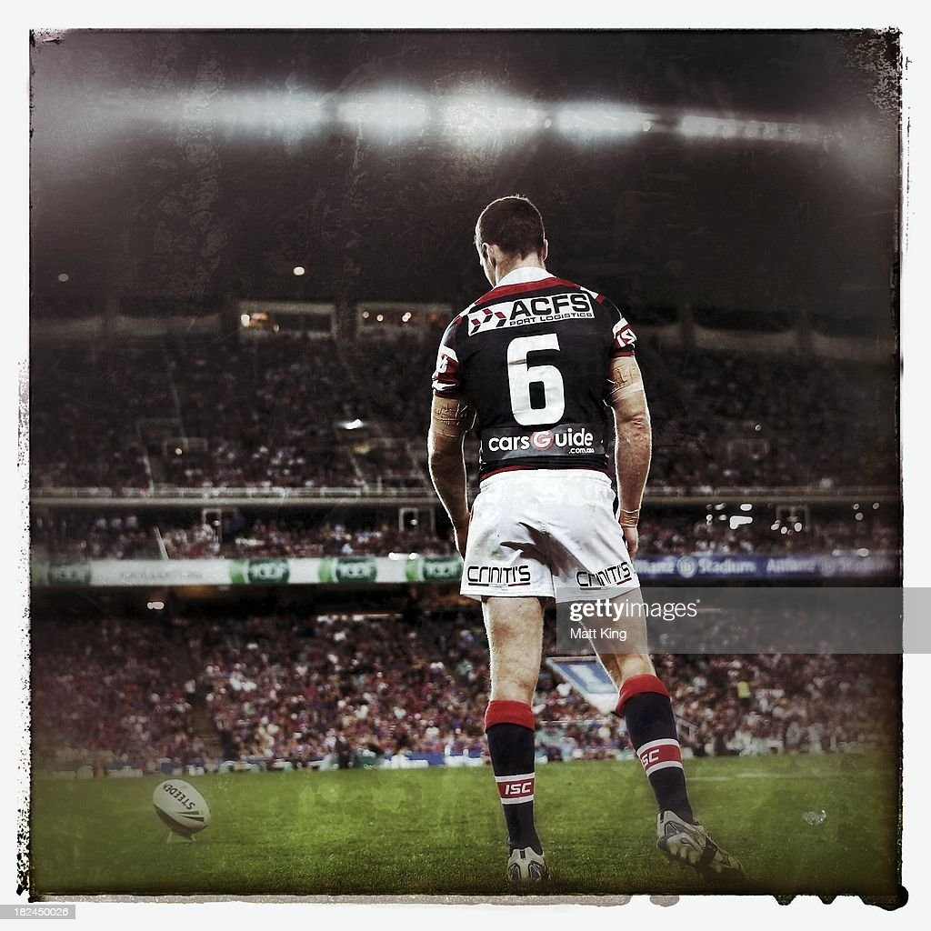James Maloney of the Roosters lines up a conversion during the NRL Preliminary Final match between the Sydney Roosters and the Newcastle Knights at Allianz Stadium on September 28, 2013 in Sydney, Australia.