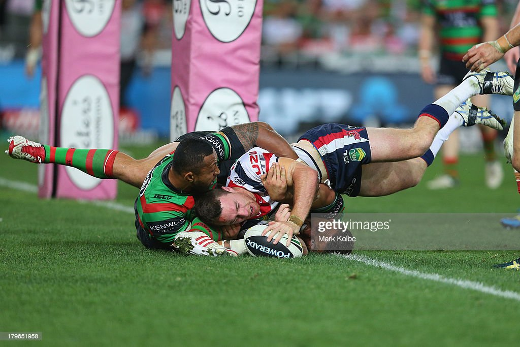 James Maloney of the Roosters scores a try during the round 26 NRL match between the South Sydney Rabbitohs and the Sydney Roosters at ANZ Stadium on September 6, 2013 in Sydney, Australia.