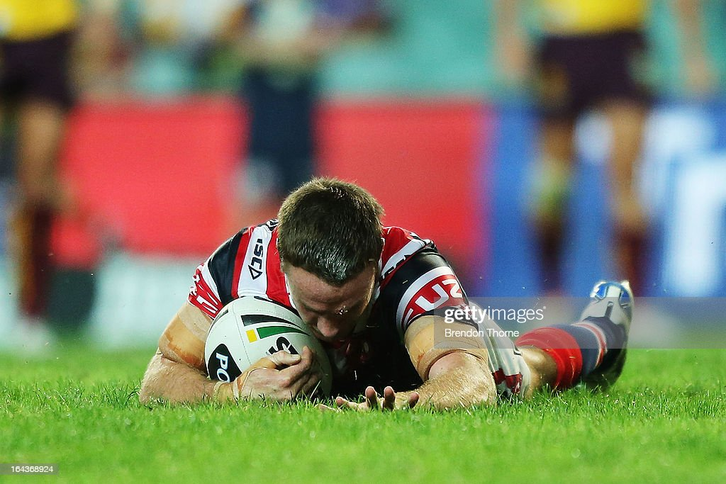James Maloney of the Roosters scores the opening try during the round three NRL match between the Sydney Roosters and the Brisbane Broncos at Allianz Stadium on March 23, 2013 in Sydney, Australia.