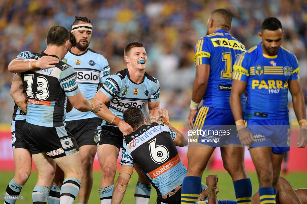James Maloney of the Sharks celebrates with Jayden Brailey of the Sharks after scoring during the round four NRL match between the Parramatta Eels and the Cronulla Sharks at ANZ Stadium on March 25, 2017 in Sydney, Australia.