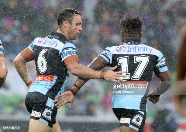 James Maloney of the Sharks is congratulated by James Segeyaro of the Sharks after kicking a drop goal during the round six NRL match between the...