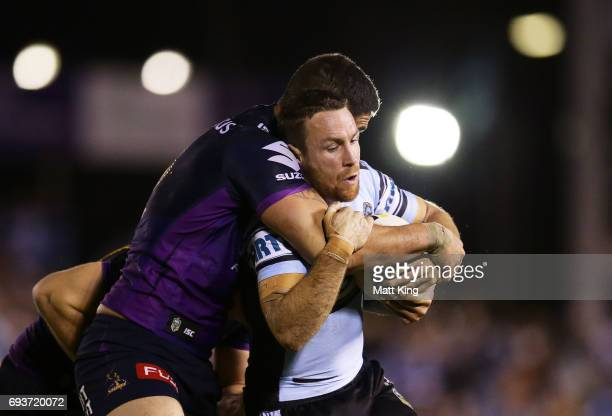 James Maloney of the Sharks is tackled during the round 14 NRL match between the Cronulla Sharks and the Melbourne Storm at Southern Cross Group...