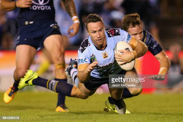 James Maloney of the Sharks scores a try during the round 11 NRL match between the Cronulla Sharks and the North Queensland Cowboys at Southern Cross...