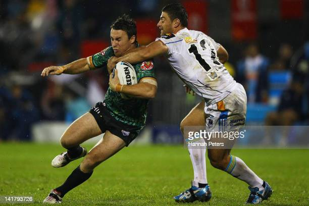 James Maloney of the Warriors is tackled by Mark Minichiello of the Titans during the round four NRL match between the New Zealand Warriors and the...