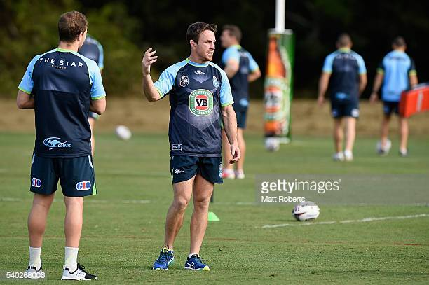 James Maloney speaks with his team mates during a New South Wales Blues State of Origin training session on June 15 2016 in Coffs Harbour Australia