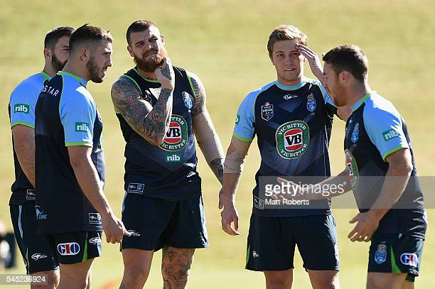 James Maloney speaks with team mates Matt Moylan Josh Dugan James Tedesco and Jack Bird of the Blues during the New South Wales State of Origin...