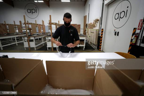 James Mammale with Architectural Plastics assembles plastic face shields on May 07 2020 in Petaluma California Architectural Plastics has seen a...