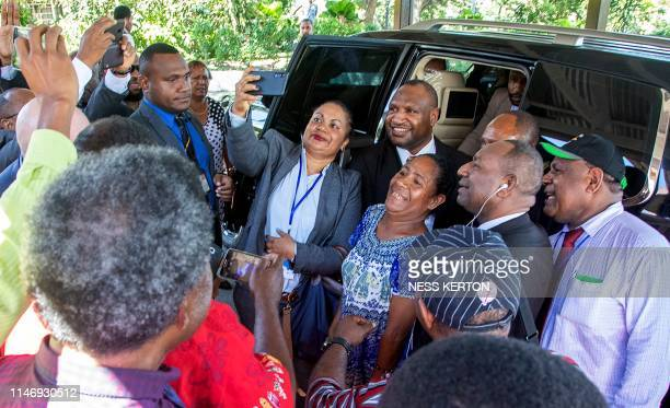 James Marape has a selfie taken by well wishers as he leaves the house of Governor General Bob Dadae after being sworn in as the new Prime Minister...