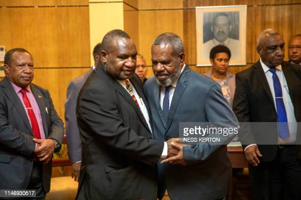 James Marape is congratulated after being sworn in as the new Prime Minister of Papua New Guinea by Governor General Bob Dadae in Port Moresby on May...
