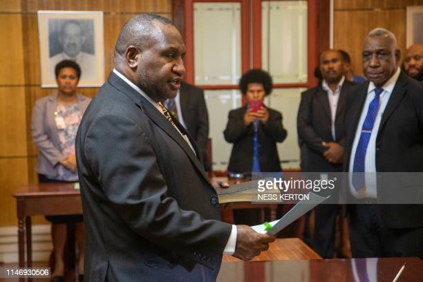 James Marape is sworn in as the new Prime Minister of Papua New Guinea by Governor General Bob Dadae in Port Moresby on May 30 2019 Marape won the...
